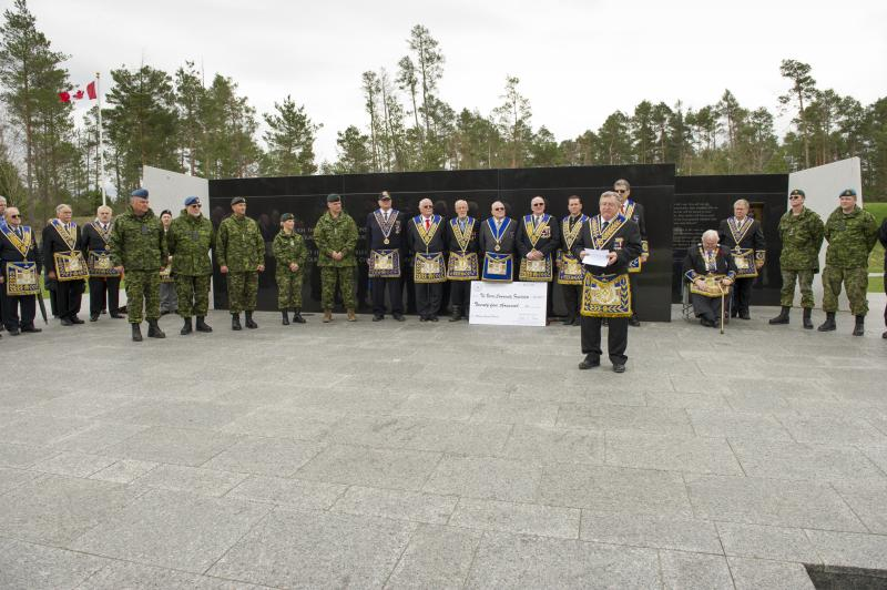 Cheque Presentation for the Borden Legacy Project from the Free and Accepted Masons of Canada at the Borden Legacy Wall, Canadian Forces Base (CFB) Borden, Ontario on May 2, 2017.                                                                                                                                  Photo: Avr Rachael Allen, CFB Borden Imagery                                                     CB06-2017-0198-005